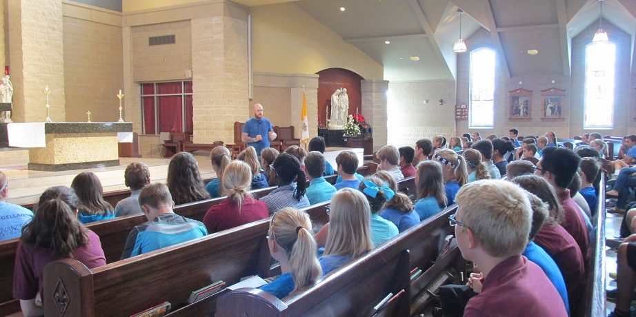 Matt Simmons speaks to the 7th and 8th Graders